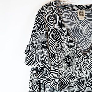 Anne Klein Tops - 3/$20 Anne Klein Tunic Black White Lion Asymmetric